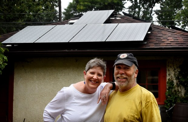 Sheila Sweeney and John Rains in their backyard by the solar array on their garage roof in St. Paul on Thursday, Sept. 22, 2016. (Pioneer Press: Jean Pieri)
