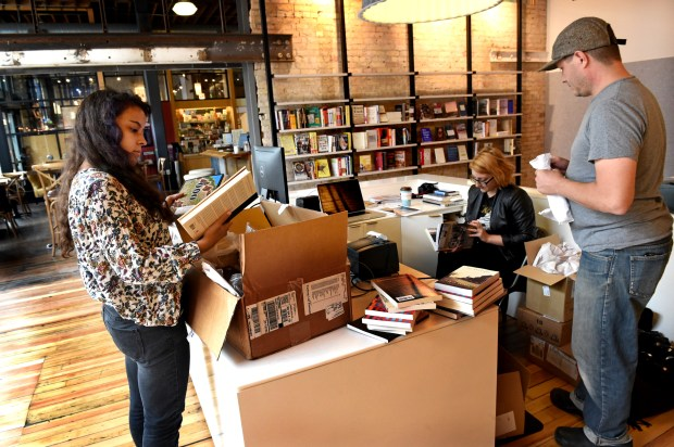 Ceila Mattison, bookseller, Daley Konchar-Farr, bookseller and events coordinator, and Hans Weyandt, store manager sort through just-arrived boxes of books at Milkweed Books in the Open Book building in Minneapolis Thursday, Sept. 15, 2016. Milkweed Books is the first bookstore in the Twin Cities that is being opened by a publisher - Milkweed Editions - which is in the same building. It opens to the public on Sept. 20. (Pioneer Press: Jean Pieri)
