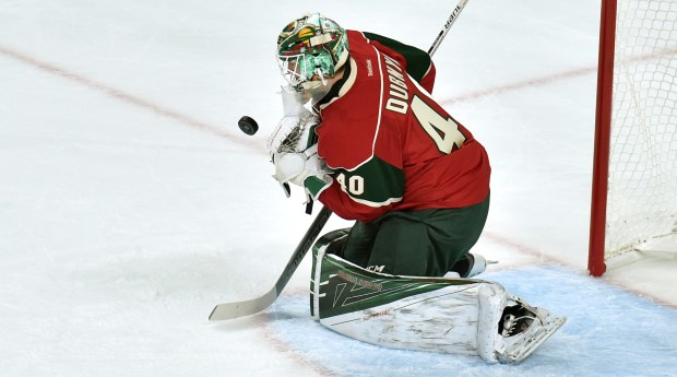 Minnesota Wild goalie Devan Dubnyk tries to scope up a bouncing puck as the Wild take on the Colorado Avalanche in the first period. (Pioneer Press: John Autey)