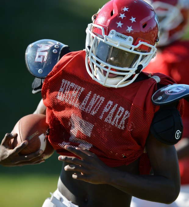 St. Paul Highland Park High School quarterback Amitri Collins-Westlund scrambles out of the pocket and picks up a few yards at practice at Highland Park on Wednesday, Sept. 14, 2016. (Pioneer Press: John Autey)