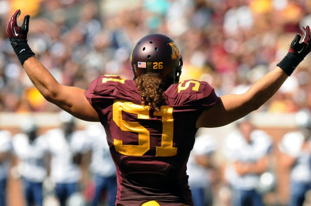 Gophers linebacker number 26 Mike Rallis wears Number 51 on his back, in memory of Gary Tinsley, who died last April, as the University of Minnesota beat the University of New Hampshire 44-7 at TCF Bank Stadium in Minneapolis on Saturday, September 8, 2012. ( Pioneer Press: Scott Takushi)