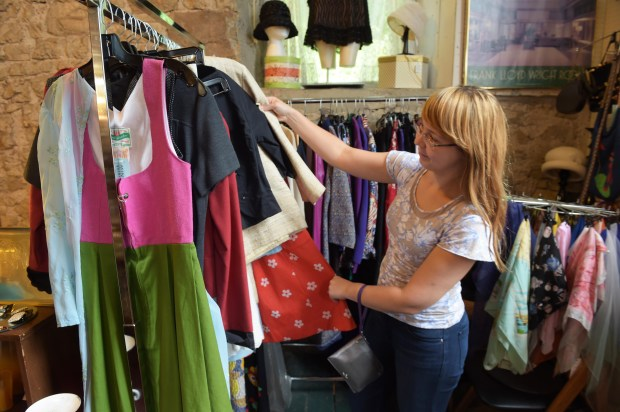 Kasia Kasiarz of Chicago checks out vintage clothing at Staples Mill Antiques in Stillwater (Pioneer Press: Scott Takushi)