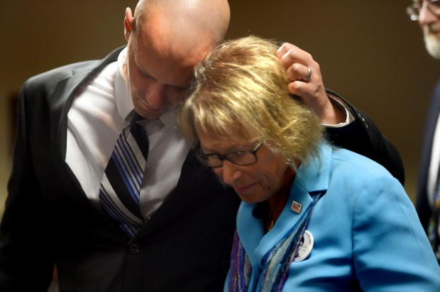 Trevor Wetterling, the brother of Jacob, hugs his mother Patty Wetterling as a team of prosecutors talk about the confession of Daniel Heinrich to the 1989 killing of Jacob Wetterling, in Minneapolis on Tuesday, Sept. 6, 2016. Heinrich, the man who led authorities to the remains of Jacob Wetterling last week, admitted in U.S. District Court today that he abducted and killed the 11-year-old boy some 27 years ago. (Pioneer Press: Scott Takushi)