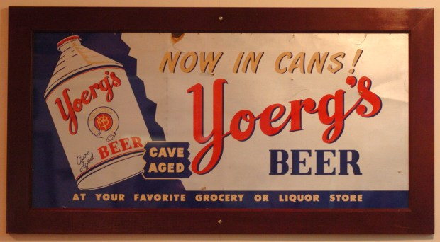 Dave Wendl is president of a beer memorabilia collecting group and has the largest collection, including signs, cans, and advertising. An advertising sign for Yoerg's beer, which was produced in a small St. Paul brewery located where Ohio Street winds up the bluff on the West Side and stored in the caves that have become so controversial.SD 9/30/2004
