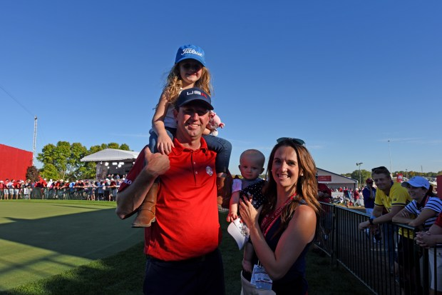 Club professional Chandler Withington, with daughter Peyton, 5, on his shoulders, wife Maureen, and 8-month-old Bryn, pose following Team USA's Ryder Cup Hazeltine National Golf Club in Chaska, Minn., Sunday, Oct. 2, 2016. (Pioneer Press: Dave Orrick)