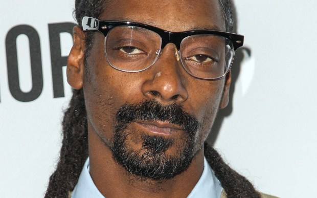 Rapper Snoop Dogg is 45. (Associated Press: Paul A. Hebert)