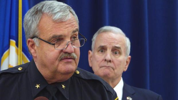 Grand Rapids Police Chief Scott Johnson tells reporters on Wednesday, Oct. 12, 2016, that a Minnesota council he will help lead will look into how law enforcement officers and community members can better trust each other. Gov. Mark Dayton is in the background. (Forum News Service photo by Don Davis)