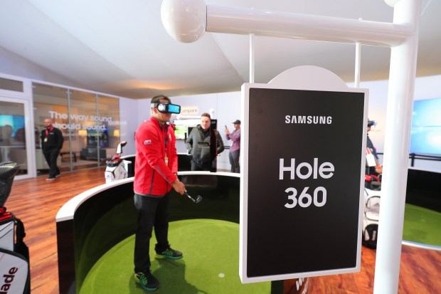 A Ryder Cup attendee tries out a Samsung virtual-reality golfing exhibit at Hazeltine National Golf Club on Friday, Sept. 30, 2016. (Courtesy photo: Samsung)