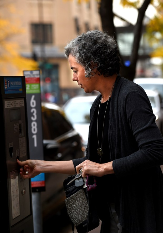 Flannery Delaney gets a receipt after paying for a parking meter on Wabasha St. in downtown St. Paul on Thursday, Oct. 6, 2016. (Pioneer Press: Jean Pieri)
