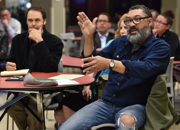 Patrick Rhone from the Cathedral Hill neighborhood in St. Paul asks a representative from the National Alliance on Mental Illness Minnesota a question at a St. Paul Police Department community meeting at St. Paul College on Wednesday, Oct. 12, 2016. (Pioneer Press: John Autey)