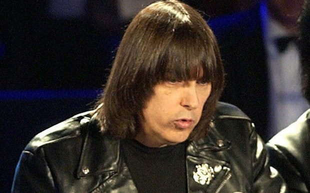 The late Johnny Ramone — guitarist and co-founder of punk pioneers the Ramones — was born on this day in 1948. Ramone, aka John Cummings, died of cancer in 2004. He's pictured in 2002. (Associated Press: Kathy Willens)