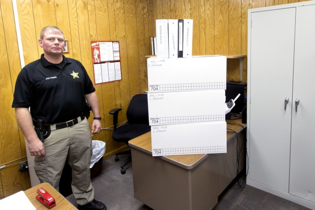 John Tinnes, Chief Deputy of the Marshall County Sheriff department. stands next to boxes and binders full of case files for the 1996 missing persons case of Veronica Safranski. (Jesse Trelstad/Grand Forks Herald)