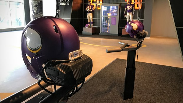 The Vikings Voyage fan experience at U.S. Bank Stadium includes a virtual-reality game that lets attendees pretend they're catching a football. VR goggles are attached to football helmets. (Pioneer Press: Julio Ojeda-Zapata)