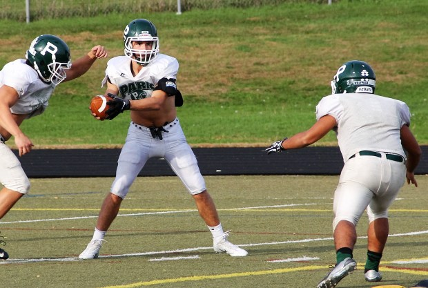 Shown working on the read-option at practice on Tuesday, Oct. 11, Park senior Brandon Alt has developed into a legitimate dual-threat quarterback. (Pioneer Press: Jace Frederick)