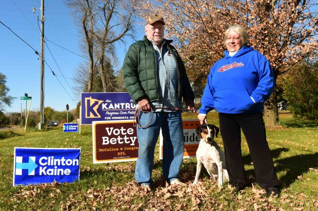 Judy Gibson and her husband Bob Pike stand with their Hillary Clinton and other DFL lawn signs on their Lake Elmo property, Monday, Oct. 24, 2016. (Pioneer Press: Scott Takushi)