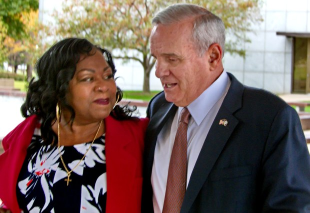 With Gov. Mark Dayton's arm around her, Valerie Castile walks across the Minnesota Capitol complex Wednesday, Oct. 12, 2016, after Dayton announced formation of a council to improve police-community relations. Castile's son, Philando, was shot and killed by a Twin Cities police officer. (Forum News Service photo by Don Davis)
