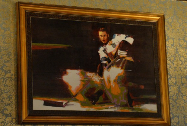 A painting of Herb Brooks playing hockey, hangs above the fireplace at Herbie's on the Park in St. Paul on Tuesday, Oct. 25, 2016. (Pioneer Press: John Autey)