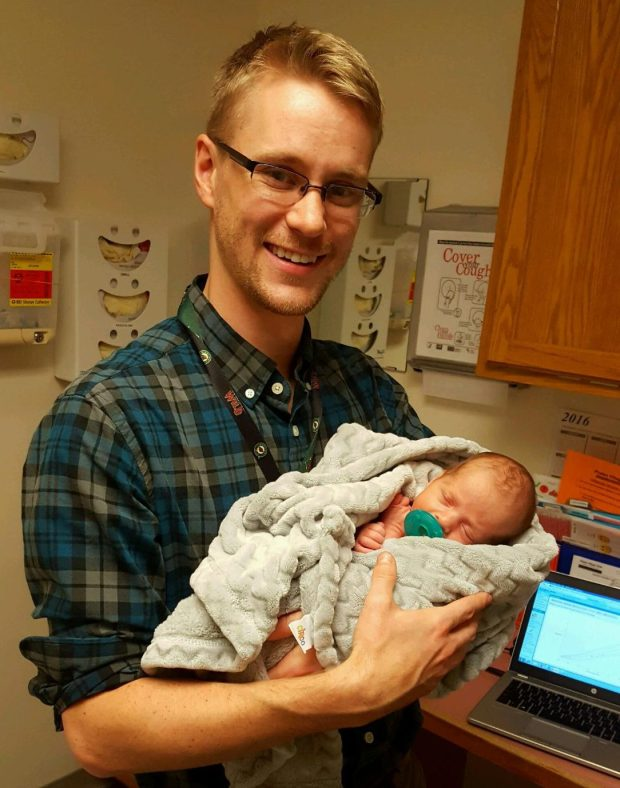 Thomas Haroldson, a second-year resident in family practice, holds the newest Fowler family member, Myles Aaron. (Courtesy: Bill Fowler)
