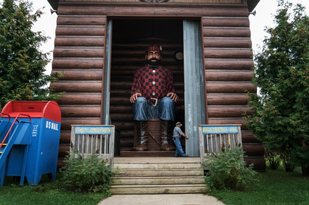 "The ""World's Largest Animated Talking Bunyan"" — 26 feet tall, seated — at Paul Bunyan Land in Brainerd, Minn., Sept. 6, 2016. In this age of hyperbole — when a presidential candidate can stick to his absurd claim of having seen ""thousands of people"" in Jersey City cheering the collapse of the twin towers — it is no exaggeration to say that many Minnesotans still hold the gargantuan lumberjack in reverence. (Todd Heisler/The New York Times)"