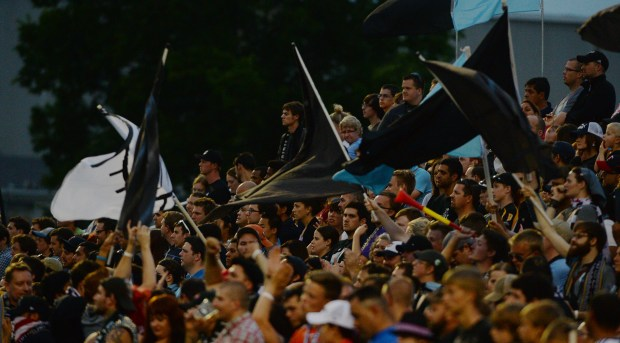 Fans wave black flags as the Minnesota United FC takes on Swansea City AFC in the second half of a soccer friendly match at the National Sports Center Stadium in Blaine, Saturday, July 19, 2014. The Loons beat Swansea City AFC, 2-0. (Pioneer Press: John Autey)