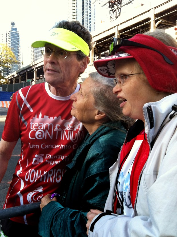 Don Wright, left, of Stillwater, stops on the sidelines of the 2011 New York City Marathon for a photo with his wife, Ardis, center, and their adult daughter, Sarah. Wright, 75, who was diagnosed with cancer in 2003, is running his 99th marathon in Des Moines on Sunday, Oct. 16, 2016. (Courtesy photo)