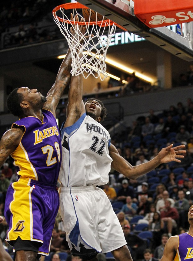 Minnesota Timberwolves forward Andrew Wiggins (22) shoots against Los Angeles Lakers center Tarik Black (28) during the first half of an NBA basketball game Sunday, Nov. 13, 2016, in Minneapolis. The Timberwolves won 125-99. (AP Photo/Bruce Kluckhohn)