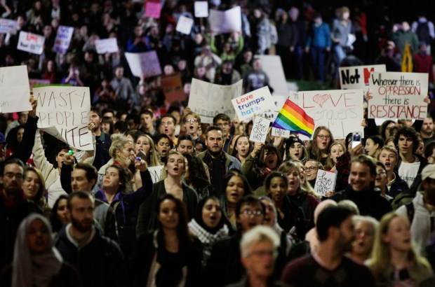 In Madison, Wis., a few thousand protesters march through Library Mall from UW-Madison's Bascom Hall to the State Capitol, protesting President-elect Donald Trump Thursday, Nov. 10, 2016. (Michael P. King/Wisconsin State Journal via AP)