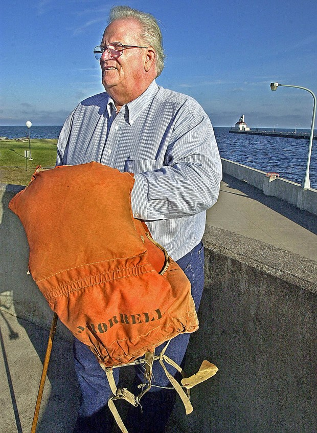 Dennis Hale, the sole survivor of the 1966 sinking of the freighter Daniel J. Morrell on Lake Huron, poses for a photo in Duluth in 2002. Hale is holding the life jacket that was cut off of him when he was rescued; he died in 2015 at age 75. (News Tribune file photo)