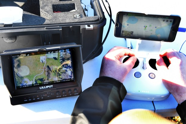 Derrick Green, from Green Remote Aviation monitors a drone when searching in Columbia Park in White Bear Lake Township on Friday, Nov. 4, 2016. His first-person view monitor, left, sits next to his transmitter with data link. His company recently helped the Woodbury Public Safety department search for a young vulnerable male.  (Pioneer Press: Jean Pieri)