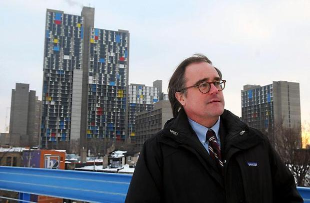 Myron Orfield, professor at the University of Minnesota Law School, stands with Cedar Riverside affordable housing in the background, on Monday, February 17, 2014. (Pioneer Press: Scott Takushi)