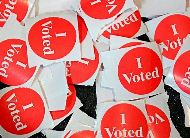 St Paul citizens received a sticker after they voted during Election Day at Nativity Of Our Lord Church in St Paul on Tuesday, November 4, 2014. (Pioneer Press: Juan Pablo Ramirez)