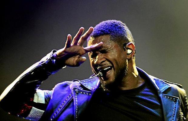 Usher performs at Xcel Energy Center on Tuesday, Nov. 18, 2014. (Pioneer Press: Juan Pablo Ramirez)
