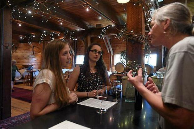 David Melbye, right, explains different types of wine to Michelle Kirkvold, left, and Martha Tipping, both of Minneapolis, at Alexis Bailly Vineyard in Hastings on July 17, 2015. (Pioneer Press: Holly Peterson)