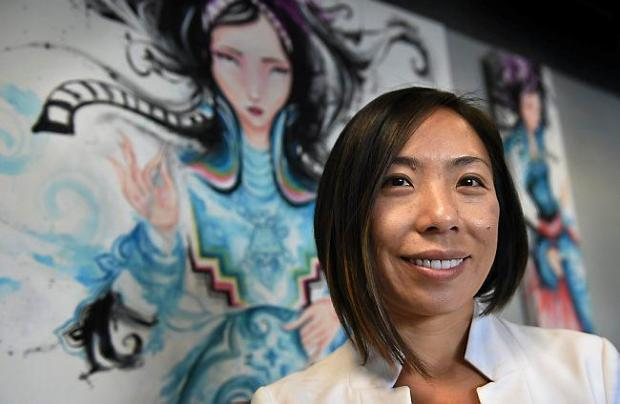 Sia Her, executive director of the Council on Asian Pacific Minnesotans, in her St. Paul office on Thursday, October 22, 2015. The council introduced legislation on violence against Asian women and children in Minnesota. (Pioneer Press: Jean Pieri)