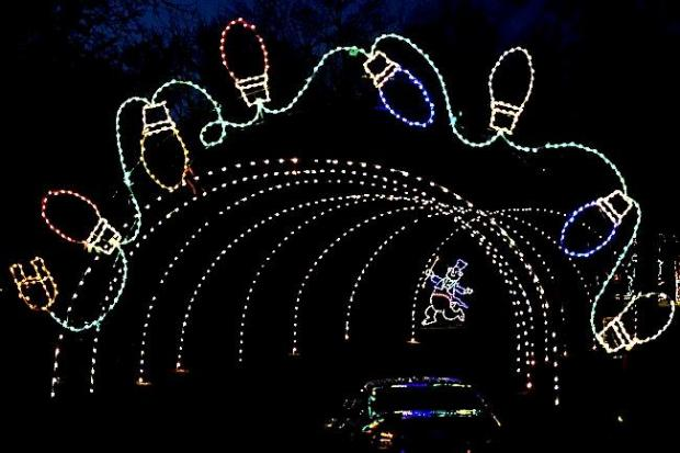 A car enters the tunnel of lights. The Saint Paul Police Foundation unveiled their annual Holiday Lights in the Park, the Midwest s largest outdoor holiday light display will illuminate St. Paul s Phalen Park for an eighth straight year. For 39 evenings Phalen Park will be lit up with a wide variety of holiday-themed displays. Visitors tour the displays in the warm confines of their vehicle, making weather a non-factor. Photographed on Tuesday, November 24, 2015. (Pioneer Press: John Autey)