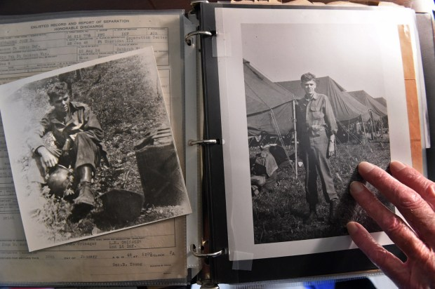 Jack Andrashko, 92, a World War II army veteran, shows photos from Germany in Woodbury on Thursday, Oct. 27, 2016. He served from March 1943 to Jan. 1946 and fought in the Battle of the Bulge. (Pioneer Press: Jean Pieri)