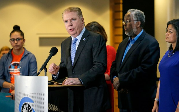 "In this Nov. 9, 2016, file photo, Seattle Mayor Ed Murray, second left, speaks at a post-election event of elected officials and community leaders at City Hall in Seattle. Leaders in Seattle, San Francisco and other so-called ""sanctuary cities"" say they won't change their stance on immigration despite President-elect Donald Trump's vows to withhold potentially millions of dollars in taxpayer money if they don't cooperate. (AP Photo/Elaine Thompson, File)"