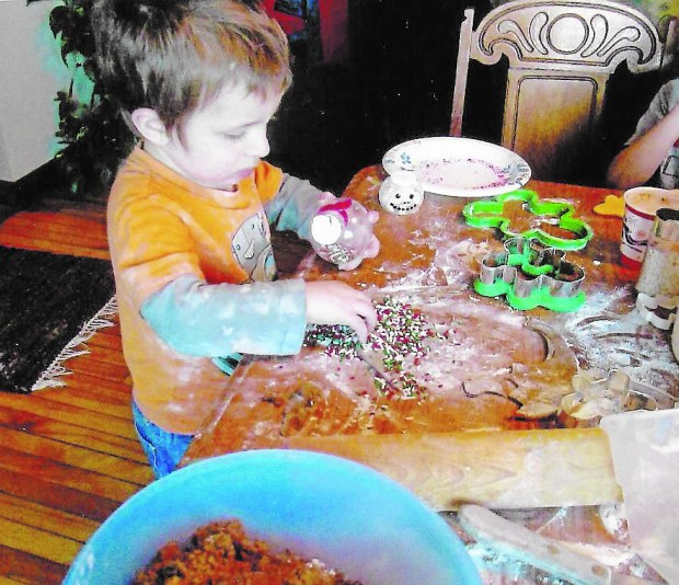 Peyton Brunner, 3, makes Oreo Cookie Balls in this family photo taken in December 2013. (Courtesy of Judi Brunner)