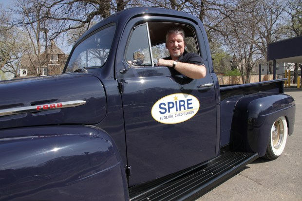 "Spire Federal Credit Union CEO Dan Stoltz and ""Archie,"" the 1954 Ford pickup that has become the symbol of the institution. (Courtesy photo)"