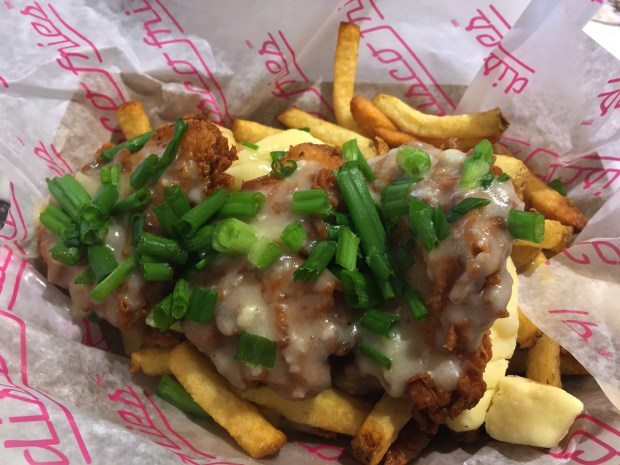 Fries topped with fried chicken, gravy and green onions at Disco Fries a the Mall of America on October 20, 2016. (Pioneer Press: Nancy Ngo)