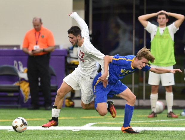 Stillwater Ponies forward Miguel Caravias gets past Wayzata Trojans defender James Ostapeic during the second half of the Class 2A championship game of the State Boys Soccer Tournament at U.S. Bank Stadium in Minneapolis on Thursday, Nov. 3, 2016. Stillwater beat Wayzata, 2-0 to claim the state title. (Pioneer Press: John Autey)