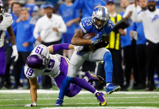 Detroit Lions cornerback Darius Slay (23) intercepts a pass intended for Minnesota Vikings wide receiver Adam Thielen (19) during the second half of an NFL football game, Thursday, Nov. 24, 2016 in Detroit. The Lions won the game 16-13. (AP Photo/Paul Sancya)