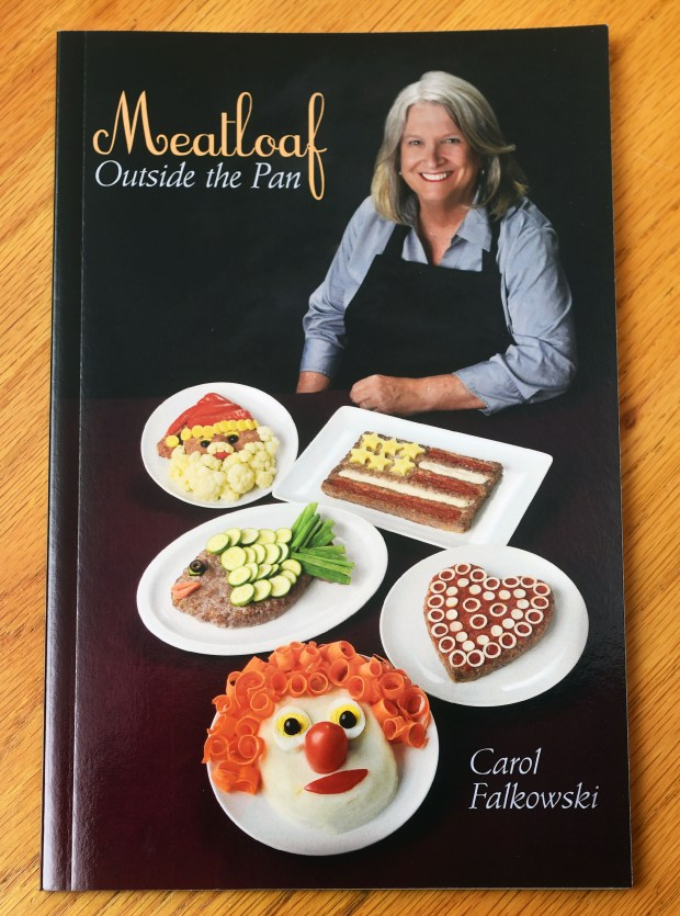 Carol Falkowski of Mahtomedi, who has published a cookbook on the many ways to decorate meatloaf, demonstrates how to Dec. 15, 2016. (Pioneer Press: Scott Takushi)