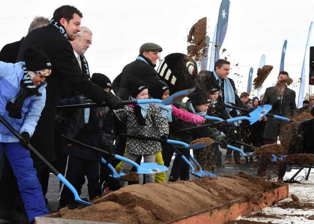 Minnesota United officials and children throw dirt during a ceremonial groundbreaking at their new stadium site near Snelling Ave. and I-94 in  St. Paul, Monday, Dec. 12, 2016. (Pioneer Press: Scott Takushi)