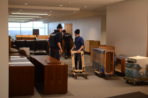 Movers navigate a growing maze of furniture and carts on the 3rd floor of the Minnesota Senate Building (Pioneer Press; Brian Edwards)