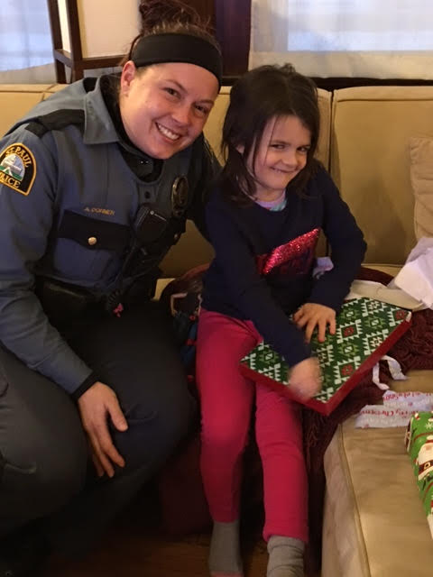 St. Paul Police Officer Amy Dorner stopped by the Burgess household Dec. 23 with some gifts for 5-year-old Ellie Burgess. Dorner was with the family Nov. 13, when Ellie's sister, 3-year-old Vivienne, died unexpectedly.