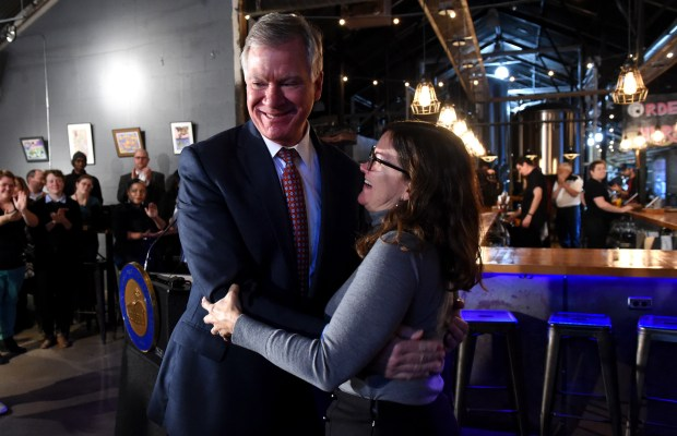 St. Paul Mayor Chris Coleman hugs his wife, Connie, after announcing he will not run for mayor in 2017 at Lake Monster Brewery in St. Paul Thursday, Dec. 1, 2016. (Pioneer Press: Jean Pieri)