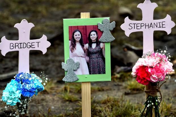 Mourners left flowers, Teddy bears, pictures and cards Friday, Dec. 2, 2016, where 16-year-old Mounds View High School students Bridget Giere and Stephanie Carlson were killed in a car crash on Minnesota 96 in Arden Hills.  (Pioneer Press: Jean Pieri)