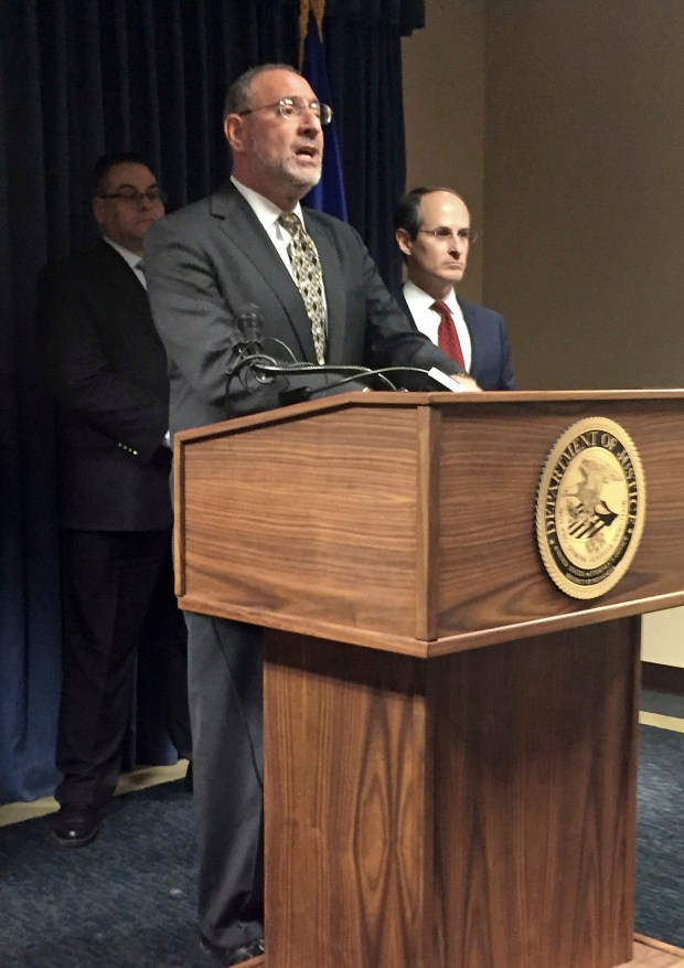 U.S. Attorney Andrew Luger, left, announces Wednesday, Dec. 21, 2016, in Minneapolis that federal authorities in Minnesota have charged 21 people with conspiracy to commit health care fraud in what they describe as separate scams by six chiropractors that defrauded auto insurance companies out of more than $20 million. Listening at right is Minnesota Commerce Commishioner Mike Rothman. (AP Photo/Steve Karnowski)
