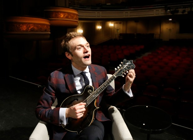 "In this April 5, 2016, file photo, Chris Thile plays his mandolin onstage at the Fitzgerald Theater in St. Paul. Thile says he still feels ""like a kid in a candy store"" taking over as host of the long-running public radio show ""A Prairie Home Companion."" Thile was chosen by creator Garrison Keillor to replace him on the Saturday evening show. (AP Photo/Ann Heisenfelt)"